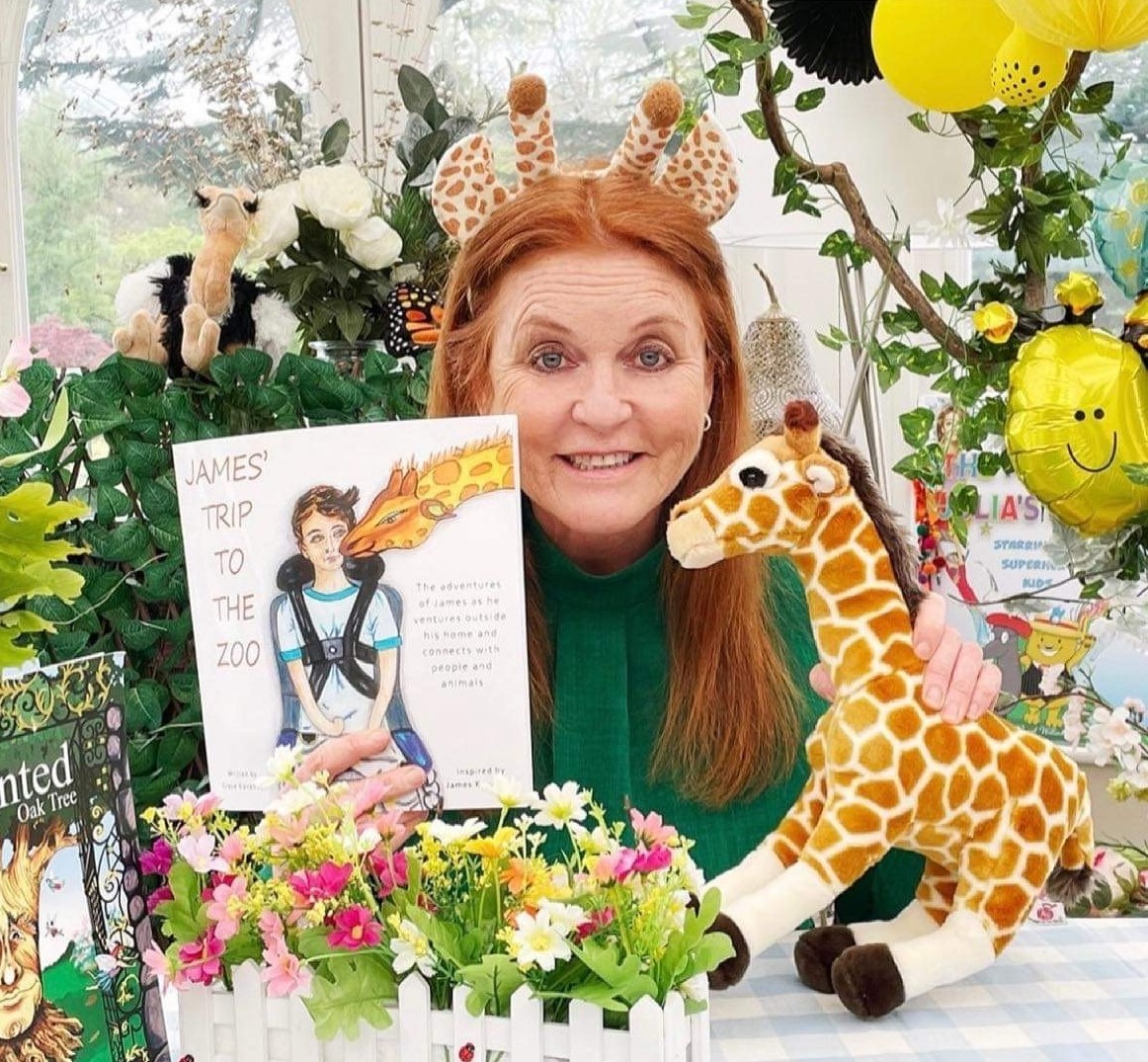 Sarah Ferguson holding children's book James Trip to the Zoo which is designed to inspire and educate people to be inclusive